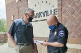 Everett Kennard, left, and Starkville Police Chief Mark Ballard discuss the issue of loud and unsafe traffic on East Gillespie Street, where Kennard lives, outside Starkville City Hall after Kennard's appearance before the board of aldermen on Tuesday. Traffic from Highway 12 has been diverted to Gillespie Street in the past couple years, and Kennard said he and other residents