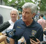 Mississippi Development Authority Director Glenn McCullough stands behind Gov. Phil Bryant at the 2016 Neshoba County Fair in this Dispatch file photo. Bryant appointed McCullough as state's chief economic developer in 2015. LINK CEO Joe Max Higgins has criticized McCullough's leadership of the department responsible for economic development in Mississippi.