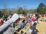 A group of about 100 members of First Pentecostal Church on Tuscaloosa Road, stopped during their clean-up efforts at their devastated church for a short service, highlighted by a baptism service.