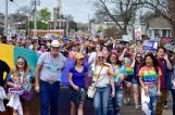 Marchers carried rainbow and equality flags as well as Pride signs through the downtown route of Starkville's first Pride parade Saturday.