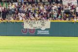 Fans hang a sign in right field thanking seniors Jake Mangum and Elijah MacNamee. Both have created memorable moments during their four-year collegiate careers that will end in Omaha, Nebraska, at the College World Series.