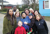 A group of volunteers are pictured in December 2010 after delivering meals in one neighborhood. In front (in red) is McKenzie Rhett. In the middle row, from left, are Margaret Cooper, Lily Stone, Liz Robinson, Tyler Rhett and Mary Riley Stone. In back are Cantwan Byrd, Melynne Stone, Boyce Frye and Penny Rhett.