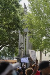 "A statue honoring confederate soldiers stands in the background during the Jesus and Justice Rally on Sunday in Columbus. Bishop Scott Volland pointed out the statue when he spoke at the rally, referring to it as ""repulsive,� and people cheered loudly in agreement with him."