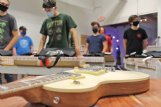 Young musicians get ready to open their kits and get to work building their own electric guitars Wednesday at The Idea Shop in Starkville. The three-part Build Your Own Guitar workshop will culminate in a community concert at 6 p.m. Nov. 12 at Cadence Bank Plaza in Starkville.