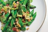Absurdly Addictive Asparagus made with crackly pancetta (bacon's Italian cousin), buttery leeks and crunchy pine nuts delivers an instant snap, crackle and crisp all in one bite.