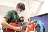 Sam Shmulsky, 17, tries out Jeffrey Rupp's Gibson ES-339 guitar at the Build Your Own Guitar workshop session at The Idea Shop in Starkville Wednesday. Sam, a Starkville High senior, is the son of Rubin and Fatima Shmulsky of Starkville.
