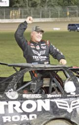 Dale McDowell celebrates winning the Cotton Pickin' 100 main event Saturday at Magnolia Motor Speedway.