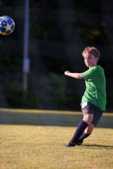 Hutch Clemons, 11, watches the ball after he kicked it towards the goal during tryouts for Columbus United Soccer Club competitive teams Thursday evening at the Columbus Soccer Complex. Clemons was one of 107 kids trying out this year, while around 20 opted out of tryouts.