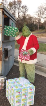 Main Street Columbus spotted the Grinch trying to steal Christmas presents in downtown Columbus before the big day. MSC Executive Director Barbara Bigelow said,