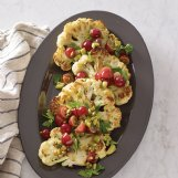Steaks? Yes, cauliflower steaks flavored with grapes, toasted pistachios, rosemary, olives and more.