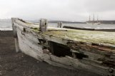 An old, weathered whaling boat sits at Whalers Bay near Deception Island in Antarctica. Beginning in the early 1900s, the bay was used by whaling, mapping and scientific expeditions.