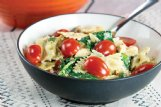 Bowtie pasta and skinless chicken breasts blend with a flavorful cast for this dish boasting a garlic cream sauce.