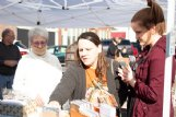 West Point residents Donna Melcher, center, and her daughter Marlee, right, peruse paper crafts on sale Saturday at the