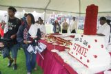 MSU students Rasheed Mitchell, of West Point, and Toni Johnson, of Jackson, check out MSU's birthday cake Tuesday afternoon. MSU celebrated its 134th birthday.
