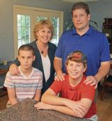 The Coblentz family Monday in their Starkville home. Clockwise are David, mom Bonnie, dad Robbie and Mark.
