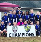The Columbus United U11 girls team poses with the championship banner after its win over the United U12 girls team at the Frostbite Tournament from Feb. 6-7 in Starkville.