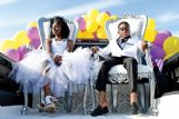 Princess Jammie Coleman and Prince Rodney Spriggs wait for the homecoming parade to start Friday afternoon at The Hitching Lot in Columbus.