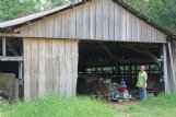 Mark Henry stands in front of a barn on his family's farm in the Morgantown community south of Sturgis. It took three generations of the Henry family to build the barn, Mark said, and he plans to restore it with boards sawed from oaks on the property.