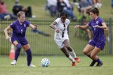 Mississippi State sophomore forward Onyi Echegini dribbles the ball through two LSU defenders Oct. 11 in Starkville. Echegini scored the tying goal in Saturday's match against Missouri as the Bulldogs and Tigers played to a 1-1 draw.