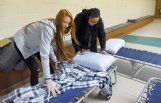 Amanda Strain of Columbus, left, and Hiedia Hozan of Aberdeen put donated pillows and blankets on cots at the temporary emergency warming shelter in Columbus Thursday. Strain and Hozan are part of an Ina E. Gordy Honors College class at The W teaming this semester with the Golden Triangle Regional Homeless Coalition, Community Outreach and the City of Columbus on the shelter project.