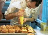Chef Dominique Ansel makes Cronuts, a croissant-donut hybrid, at the Dominique Ansel Bakery in New York on June 3, 2013. The pastry chef introduced it in May 2013, and bakeries in London, Toronto, Seoul and elsewhere have copied it.