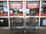 Two shopping carts bar the door of Lowe's in Columbus on Thursday morning. A sign on the door stated that the store is closed until further notice.