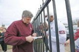 New Mississippi State head football coach Mike Leach signs autographs for fans gathered Thursday at George M. Bryan Airport after Leach arrived in Starkville. He has previously served as head coach for Washington State and Texas Tech.
