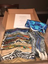 A box of Debby Lawrence's masks is ready to send out, complete with instructions for cleaning and reuse.