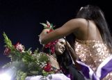 Columbus' 2018 Homecoming Queen Hannah White crowns Nitirah Barry homecoming queen during the halftime ceremony at Friday's game.