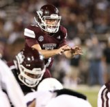 Logan Burnett takes a snap for Mississippi State. During his four year career with the Bulldogs Burnett appeared in just six games at quarterback.