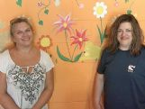 Corinne Beauregard, left, and Jeannie King are pictured in front of a mural they painted at The Pet Nanny animal boarding facility in Steens.