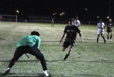 New Hope sophomore Hayden Dodson (1) pulls up as Vicksburg's goalkeeper collects the ball during the first half of Tuesday's playoff match. Just two minutes later, Dodson scored his second goal of the season to put the Trojans up 5-0.