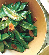 Snow peas with toasted almonds, minced shallot and lemon juice are simple to prepare.