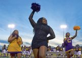 From left, Khalilah Karriem, 15, Avani Poindexter, 16, and Kamyrn Bowen 17, cheer for the Falcons during the homecoming game Friday night at the Columbus High School football stadium. Poindexter was the varsity cheer team sweetheart for homecoming.