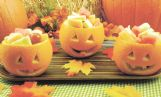 A jack-o-lantern fruit salad in individual oranges is a festive twist to Halloween gatherings for youngsters or adults.