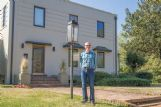 David Richardson stands in front of the 1936 home on Sixth Avenue South he shares with his wife, Kazie.