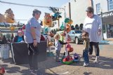 Cros Hathcock, center, and Mason Morton, both 2, examine the decorated gourds on display Saturday at the