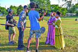 "An HBO crew films MSMS seniors Taniya Bland and Sierra Reyndols, during a dress rehearsal for the MSMS Eighth of May celebration Tuesday afternoon at Sandfield Cemetery. The HBO documentary, which features the MSMS production, will highlight six different cities across the United States and is based on James and Deborah Fallows' book ""Our Town.�"