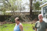 Sherian Powe, left, and husband Mike walk through their backyard in Westlake, Louisiana. The Powes did not evacuate ahead of Hurricane Laura and rode out the storm in a hallway in the middle of their house.