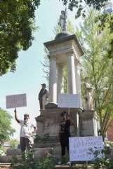 From left, John Lewis and Sonniah Ramirez, 12, protest for the removal of the Confederate monument that stands on the Lowndes County Courthouse lawn on Monday in Columbus. Lewis was protesting by himself when Sonniah approached him.