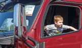 Matthias Hanes, 4, climbs out of the cab of a tractor-trailer during the United Way of Lowndes County's Little Hands, Big Trucks event at the Soccer Complex in Columbus Saturday morning.