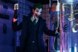 This scene with The Joker is lit with blue and red glow sticks. Studdard also uses saved phone screens or a photographic device known as a soft box to illuminate his shots.