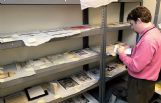 Special Collections librarian and Mississippi University for Women archivist Derek Webb reviews items drying at MUW after suffering water damage at the R.E. Hunt Museum.