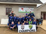 The Columbus United U11 boys team poses with the championship poster after its win at the Frostbite Tournament from Feb. 6-7 in Starkville.