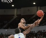 Mississippi State's Robert Woodard II, right is fouled by New Orleans' Damion Rosser (1) during the second half of their NCAA college basketball game on Sunday in Starkville.