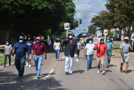 Protesters march through the streets during the Equality and Justice March on Saturday in Columbus. About 60 people gathered to continue to demand Lowndes County District 1 Supervisor Harry Sanders' resignation in response to racist remarks he made on June 15 after a supervisors meeting. / Photo by: Claire Hassler/Dispatch Staff