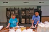 Angella Baker of Starkville Community Church, left, and Angelia Knight, a Mississippi State volunteer, plate food for people in need of a meal Saturday at the Episcopal Church of the Resurrection in Starkville.