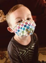 Banks Stone, 4 1/2 years old, wears a child-sized mask made by his grandmother, Diane Stone. Banks' parents are Matt and Leah Stone of Caledonia.