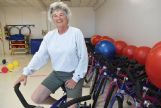 Franklin Academy physical education teacher Terrie Gooch takes a spin on one of the stationary bicycles at the school. Gooch uses a wide variety of activities to keep her students engaged and moving.