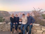 Amy Neely Adkins with her husband and three children during a vacation to the Grand Canyon last year. Adkins is a far cry from DeLois Price, the character she has played on TV commercials for Carl Hogan Automotive for the past 20 years.